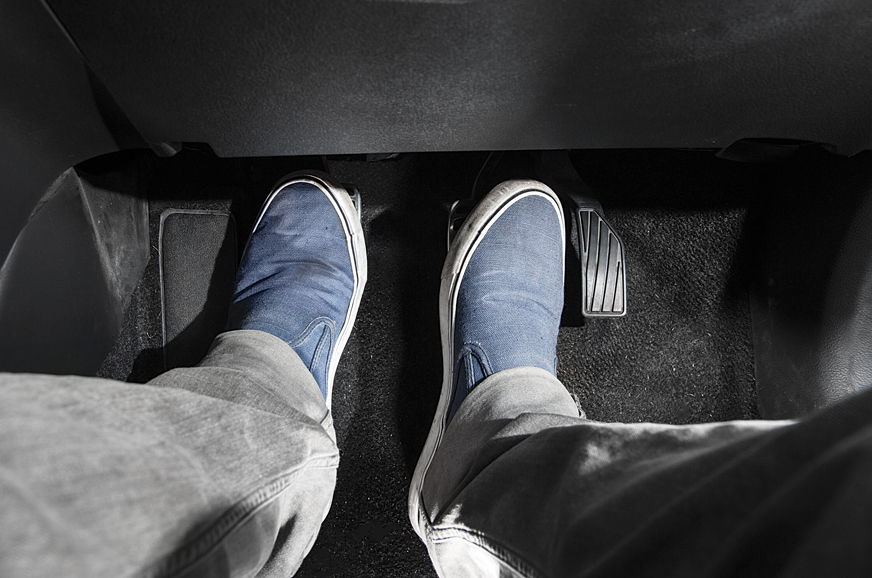 Use the left foot to push in the clutch pedal.