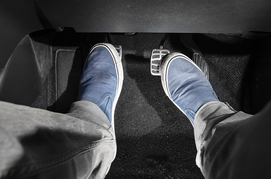Rotate the right foot so the heel is above the corner of the accelerator. Use the heel to give a quick push of the gas pedal to rev the engine quickly.