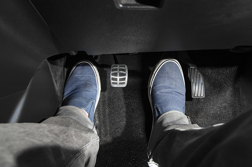 The left foot releases the clutch, the right foot rotates off the accelerator.